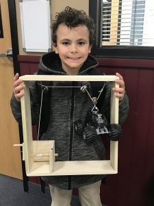boy and pulley system