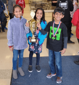 chess students with trophy